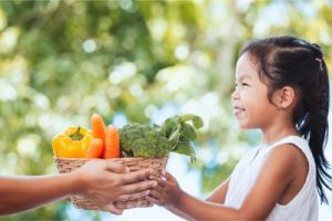 girl taking vegetables